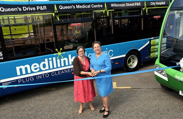 Photographer Angela Ward Lead  Nottingham City Council Portfolio Holder for Transportation and Planning Councillor Jane Urquhart  and Transport Minister  Baroness Kramer mark the  next milestone in Nottingham?s electric bus project  at the Queens Drive Eco Hub  The next milestone in Nottingham?s electric bus project will be marked at 4.00pm on 12th June 2014 at Queens Drive Park and Ride as Transport Minister Baroness Kramer visits the site.    Date: 04 June 2014  www.nottinghamcity.gov.uk   PR 7007    For Immediate Release  Nottingham?s electric dreams continue to become a reality   Photo call: 12th June 4pm ? Electric Bus Demonstration opening - Transport Minister Baroness Kramer and Nottingham City Council Portfolio Holder for Transportation and Planning Councillor Jane Urquhart  The next milestone in Nottingham?s electric bus project will be marked at 4.00pm on 12th June 2014 at Queens Drive Park and Ride as Transport Minister Baroness Kramer visits the site. The visit marks the electric bus network?s extension onto the Medlink service and the establishment of the Queens Drive Park & Ride site as a demonstration ?Eco Hub?. The first stage of the electric bus project has successfully operated for over a year, with four fully electric buses used on Centrelink, operated by Trent Barton from Broadmarsh Bus Station, and four electric Locallink services run by Nottingham Community Transport.  This latest stage of the project sees a further £5 million to put 17 electric buses into operation by Community Transport on Medilink followed by further Locallink services in autumn 2014.  The final stage will see another 11 electric buses on the high frequency Citylink Park and Ride services to the city centre in autumn 2015.  Medilink Electric is a partnership between Nottingham City Council, Nottingham Community Transport and the Nottingham NHS Health Trust. It provides a free accessible bus service, serving the City Hospital and Queens Medical Centre via two Park & Rides sit